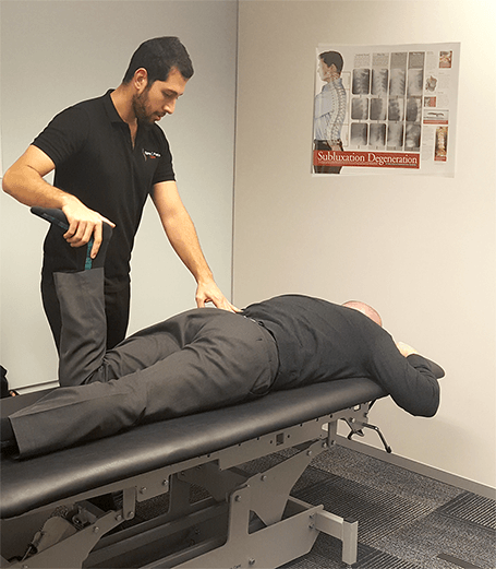 Sydney CBD chiropractor moving patients leg