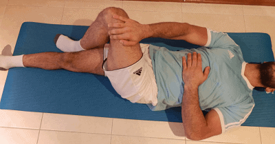 Sciatica exercise to stretch the muscle of the outer hip on left leg